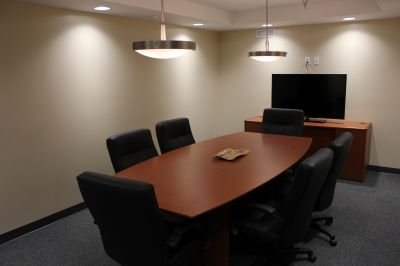 Conference room with TV presenter